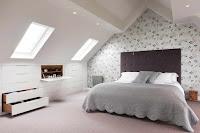 Floral wallpaper as bedroom backsplash