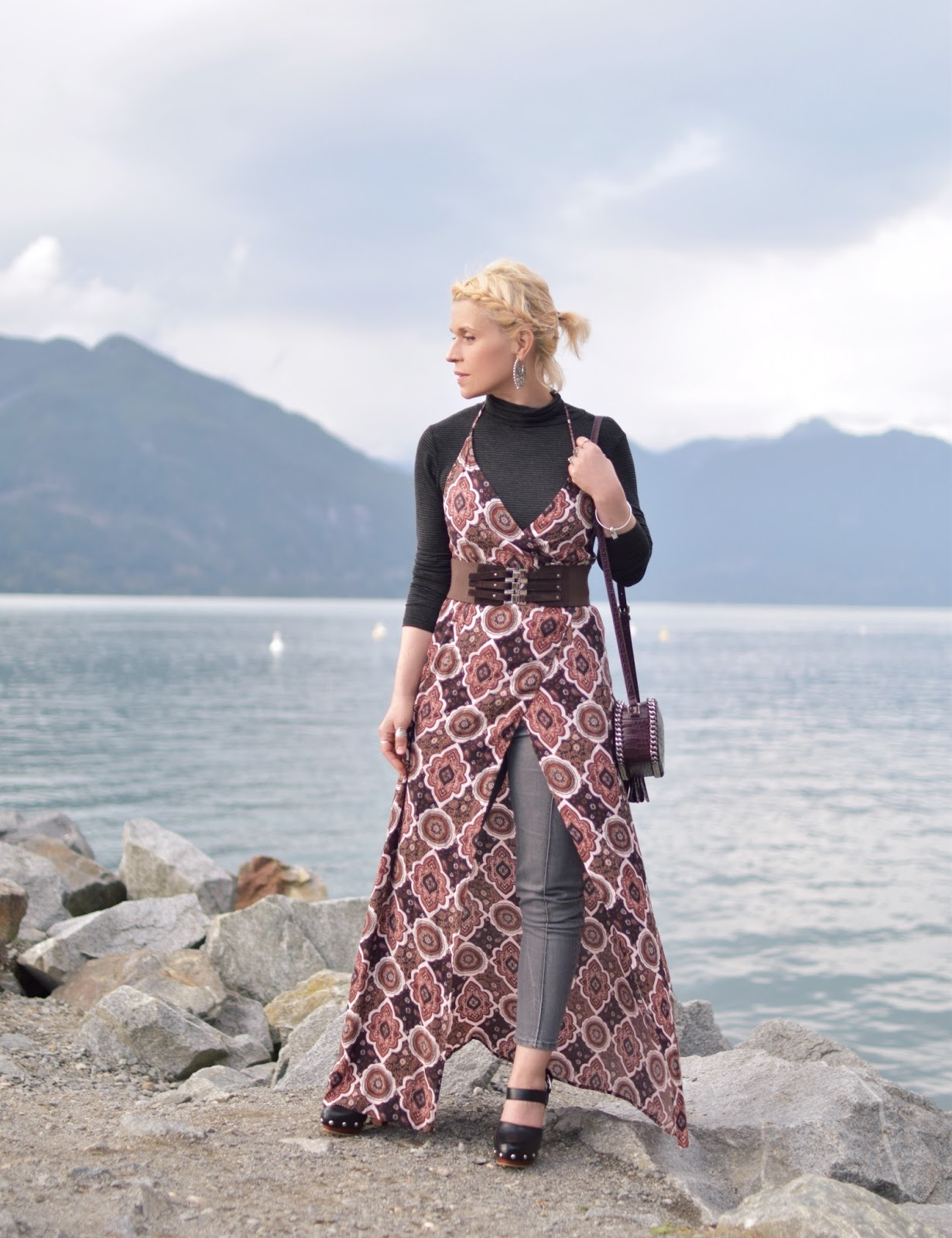 Monika Faulkner styles a patterned wrap-front slip dress over a turtleneck and grey skinny jeans