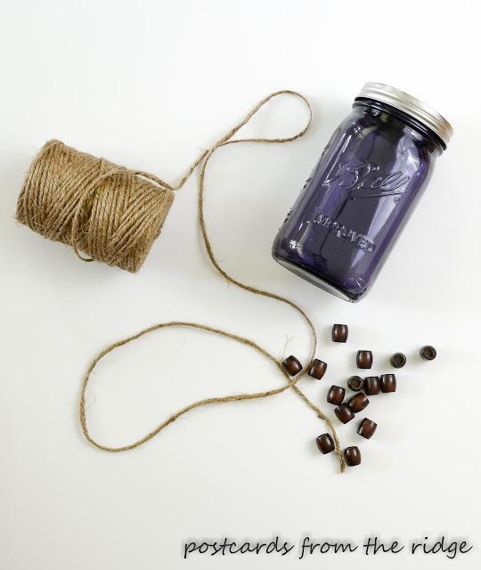 twine, wood beads, and a purple mason jar