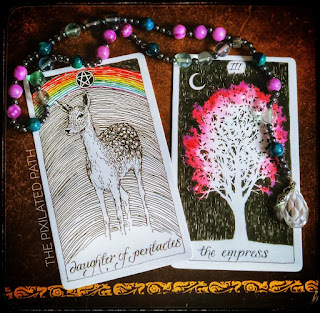 Daughter of Pentacles and The Empress cards from The Wild Unknown Tarot