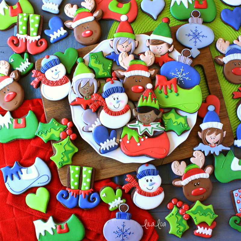 Brightly colored and fun Christmas sugar cookies - snowman, elves, holly, and reindeer
