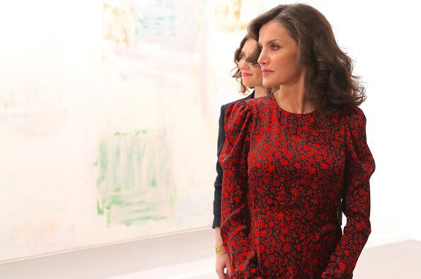 Queen Letizia wore a new printed satin dress by Maje. Prada leather pumps