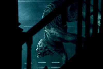 Scary Stories to Tell in the Dark 2019 movie still featuring The Jangly Man coming down the stairs of a haunted mansion