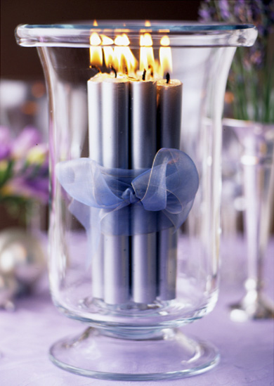 These lilac candles wrapped in ribbon pair well with the table's purple theme.