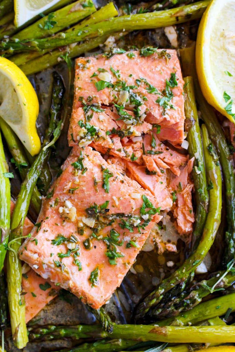 Top view closeup of Lemon Butter Salmon and Asparagus on a sheet pan.