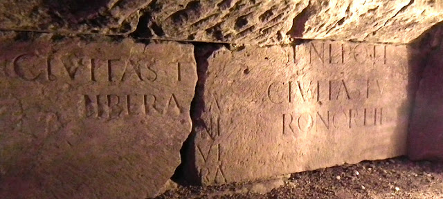 Reused stone with a Roman inscription in the foundations of the Tours city wall.  Indre et Loire, France. Photographed by Susan Walter. Tour the Loire Valley with a classic car and a private guide.