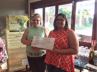The Sycamore receives a cheque donated by quota carindale