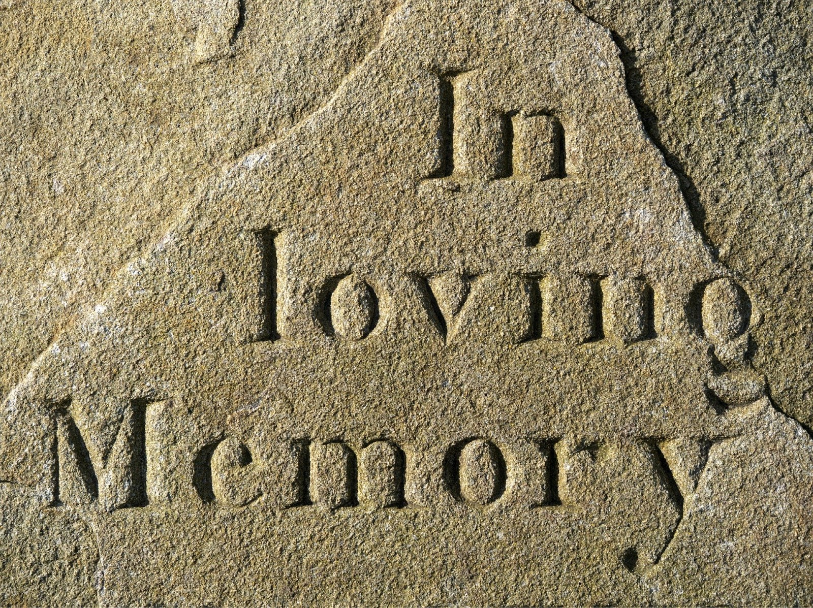 """the words """"in loving memory"""" carved into a stone for a blog post about the anniversary of operation gothic serpent"""
