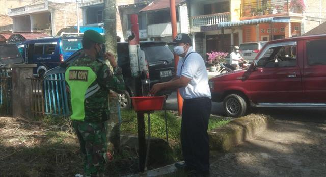 Himbau Selalu Pakai Masker Dipajak Horas Siantar, Personel JAajran Kodim 0207/Simalungun Tegakkan Protokol Kesehatan