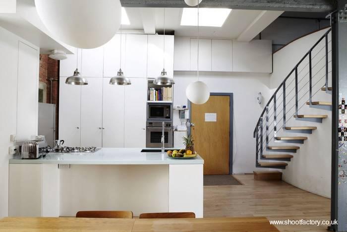Arquitectura de casas cocina minimalista en un extenso y for Casa tipo minimalista