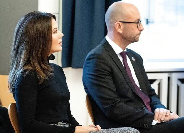 Crown Princess Marie wore a multicolour wool pants from Celine, and ruffled high collar and sleeve black sweater. Gianvito Rossi suede boots