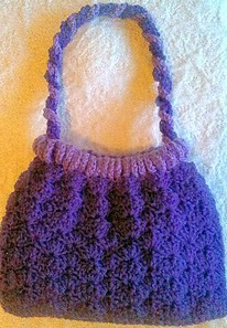 http://www.ravelry.com/patterns/library/purple-passion-purse