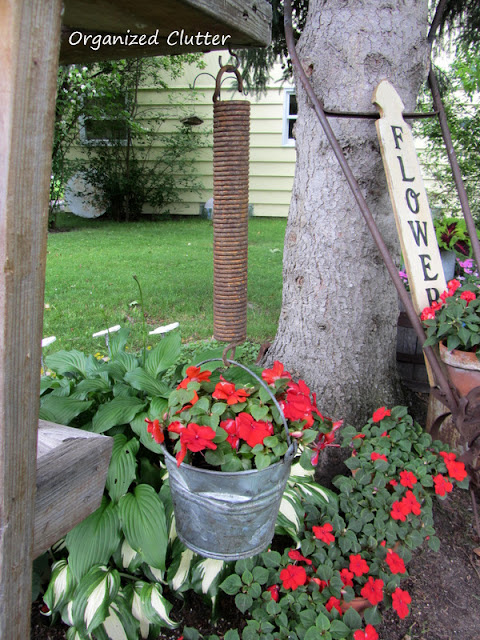 Photo of a large spring holding a flower bucket on the deck.