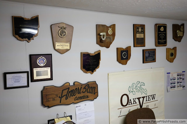 a wall of plaques won by Oakview Farms