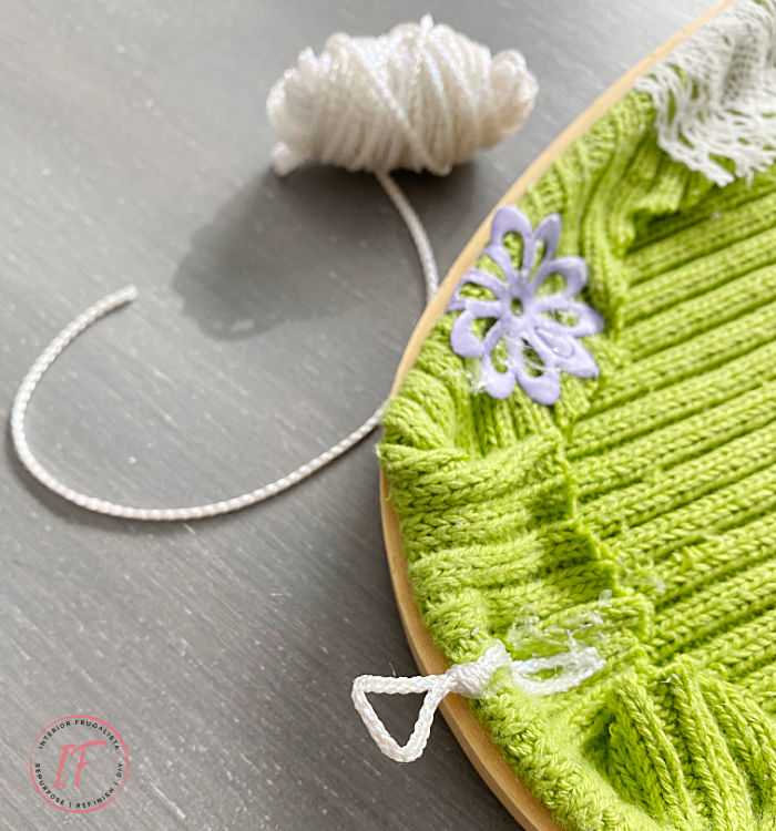 Two simple handmade Easter Egg Embroidery Hoop Wreaths, an easy ten-minute spring craft idea with recycled sweaters and seasonal ribbons.