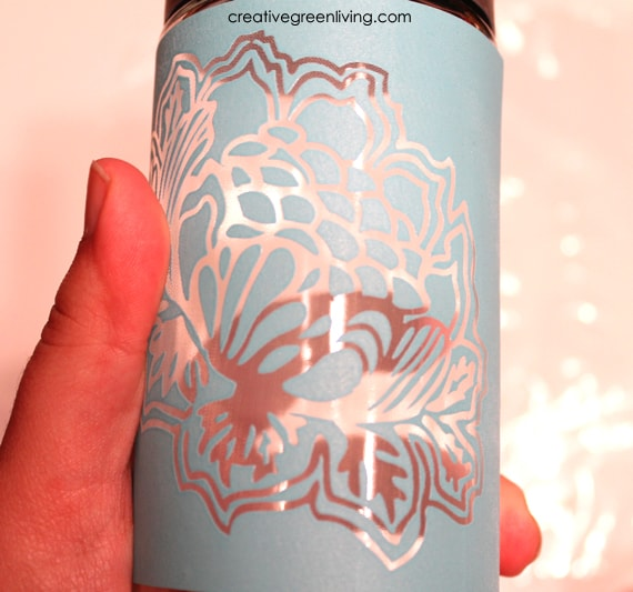 How to make a DIY water bottle using a Voss water glass bottle, Martha Stewart etch cream and Martha Stewart wilkd flowers adhesive silkscreens.