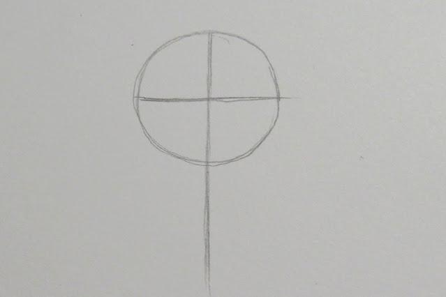 Dibujo con lápiz a mano alzada de un círculo por el que pasan dos líneas que lo dividen a la mitad, una de ellas de forma horizontal y otra de forma vertical