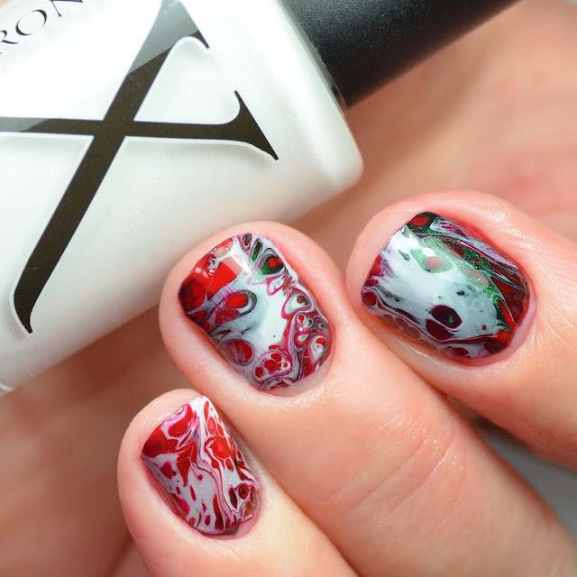 fluid art nail polish created with christmas colors