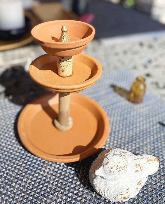 terra cotta tiered tray with cork and spool