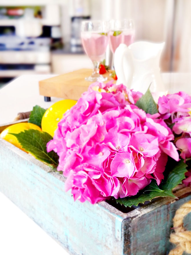 decor on kitchen island - flowers and fruits - oranges