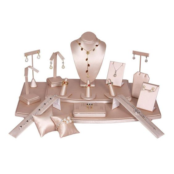 An 18-piece champagne pink jewelry display set.