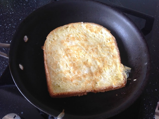 Eggy bread in frying pan