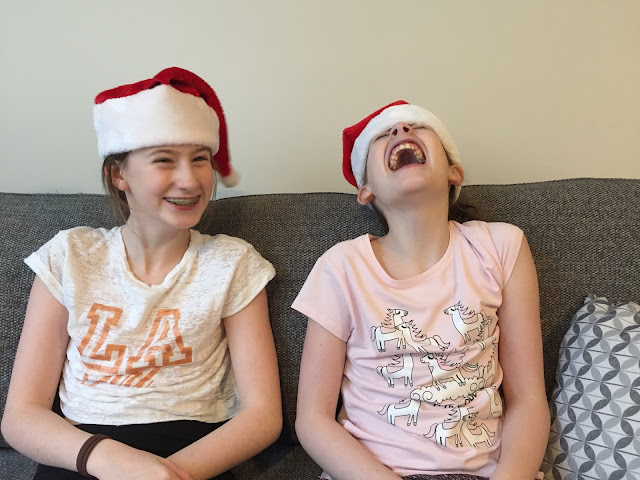 stephs two girls in christmas hats, laughing