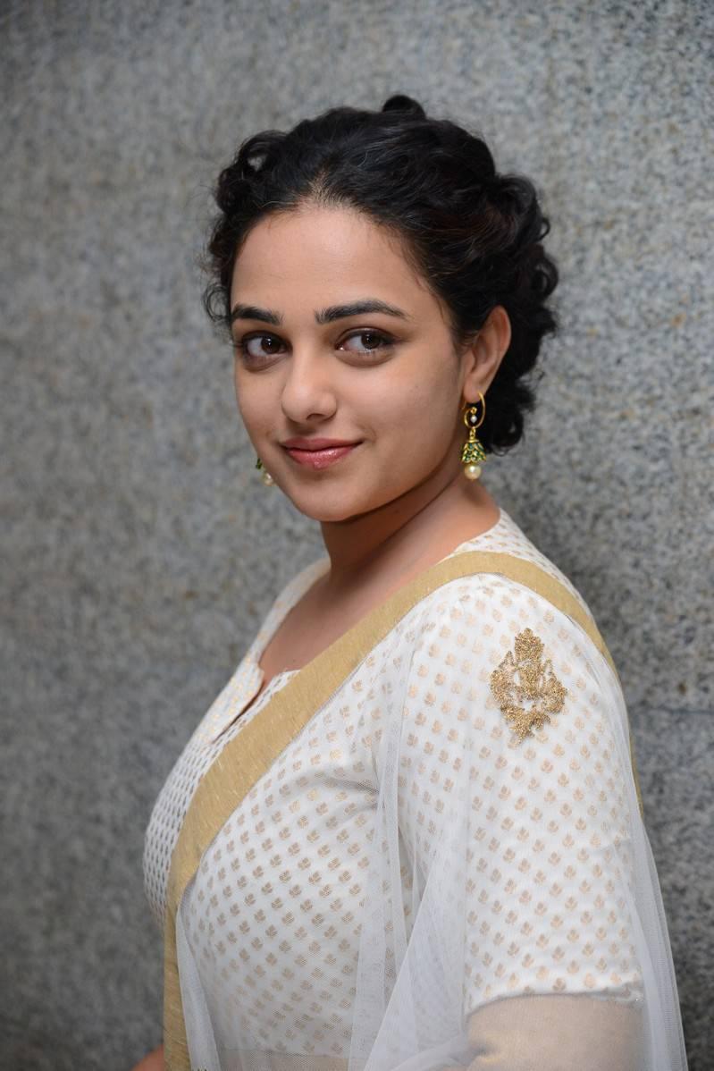 Actress Nithya Menon Stills At Movie Press Meet In White Dress