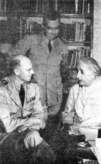 Albert Einstein conferring with naval officers in his study at Princeton, New Jersey, July 24,1943. (National Archives)