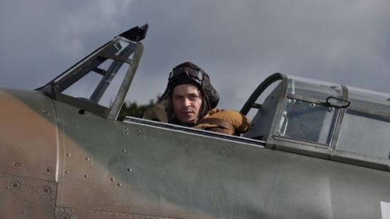 Iwan Rheon sitting in a Hawker Hurricane