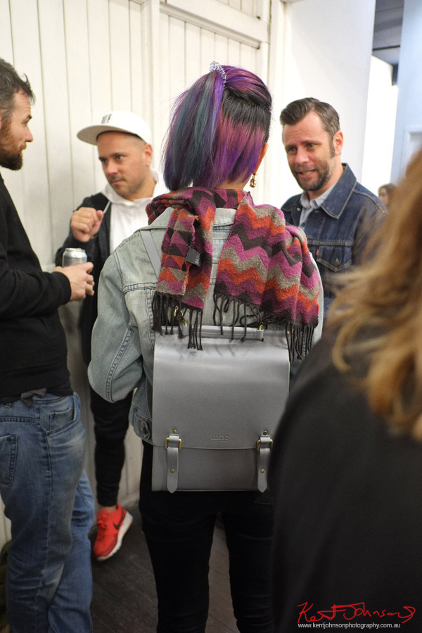 Scarf and Hair in sliver and magenta colours, silver backpack. Photography by Kent Johnson for Street Fashion Sydney.