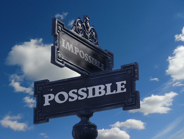 2 signs that says impossible and possible