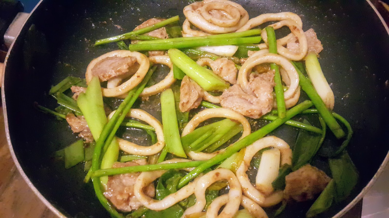 Stir fry calamares or calamari cooked with oil in a frying pan