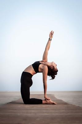 Women-in-black-doing-yoga