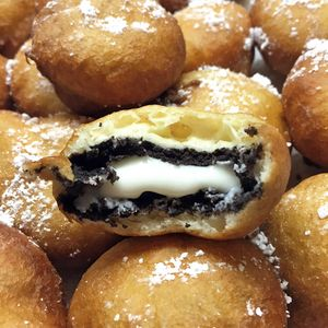 Everyone's favorite indulgent fair food is quick and easy to make at home. Pancake mix creates a fluffy, golden-brown fried dough and yields a warm and melty oreo creme center!