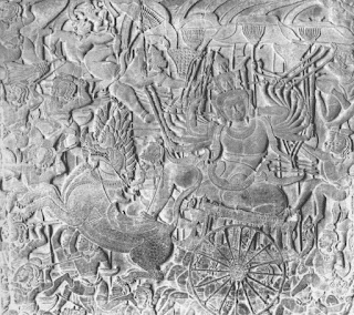 सिंह जोडलेल्या रथामध्ये रावण. दहा तोंडे एकावर एक अशा तीन पातळ्यात आहेत