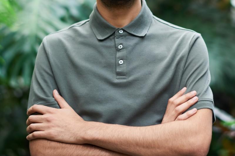 A man wearing a grey colour polo t-shirt.