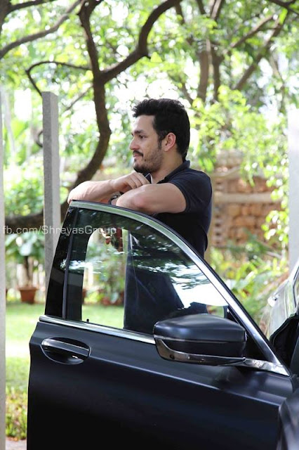 Akkineni Nagarjuna,Akhil pose with New BMW Car
