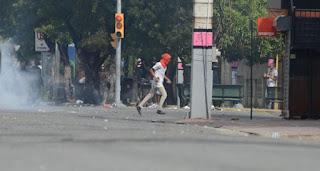 Resultado de imagen para Encapuchados realizando disturbios en la UASD