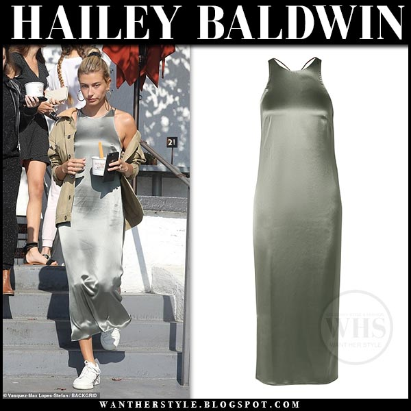 40d0ed8a33a Hailey Baldwin wearing grey silver satin Deveaux midi dress and white  Adidas sneakers. Model off