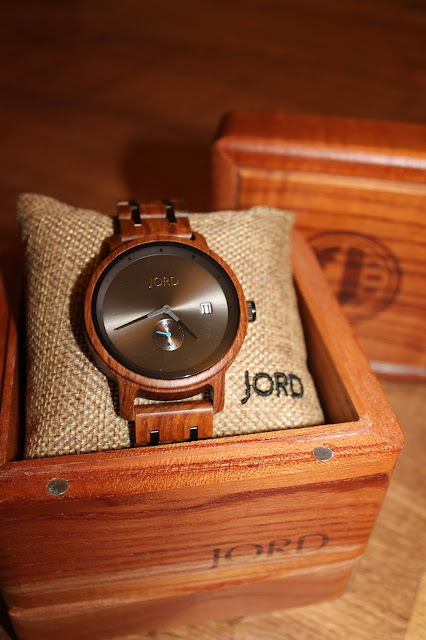 wooden watch around a hessian pillow inside a wooden box