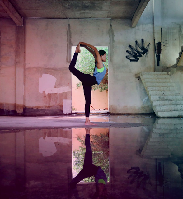 Woman Stretching In Empty Room