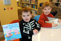 Brothers holding Peppa Pig books