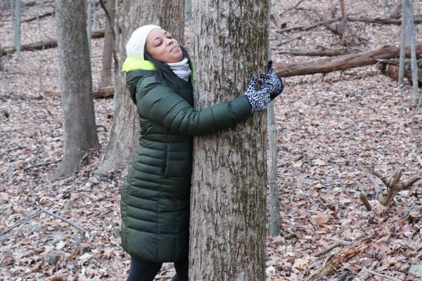 Tree hugger hugging a tree