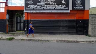 Woman walking along street in Costa Rica