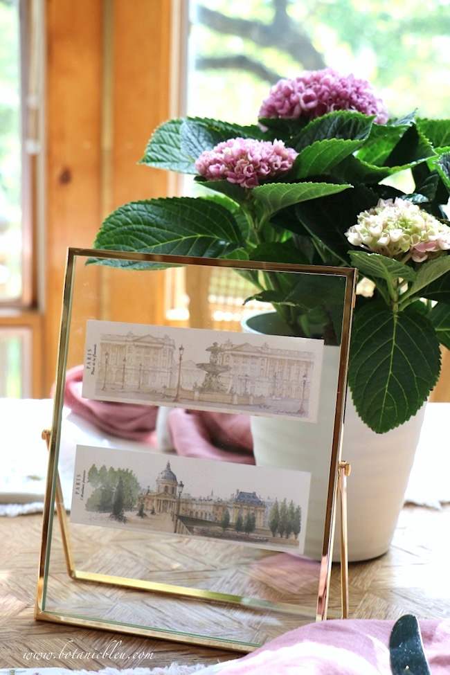 Two Paris prints in a floating frame are a beautiful way to display vacation cards