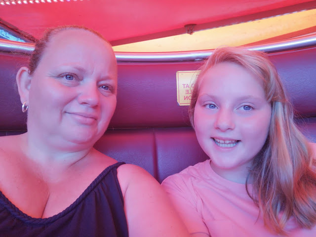 Mother and daughter on waltzer