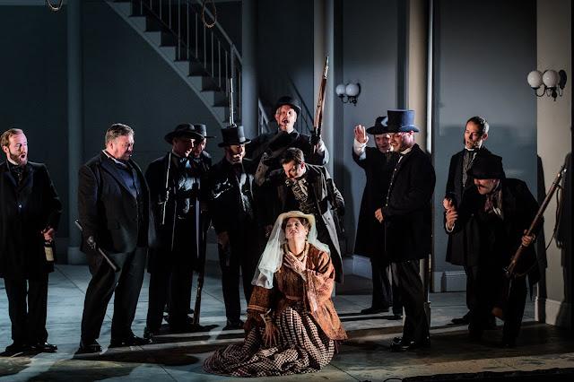 Verdi: Un ballo in maschera - Matthew Stiff, Claire Rutter & Chorus - Grange Park Opera (Photo Robert Workman)
