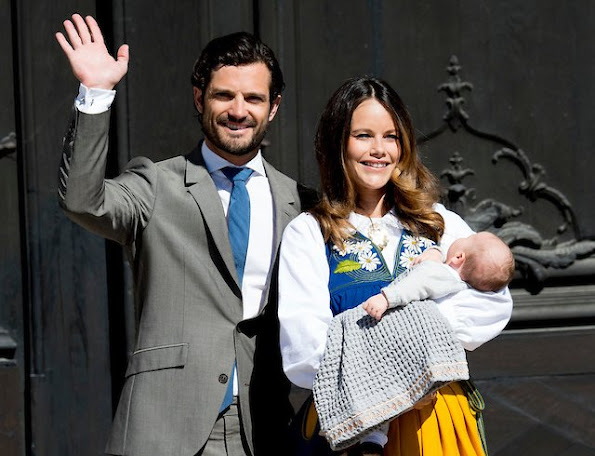 rince Carl Philip of Sweden, Princess Sofia of Sweden and son Prince Alexander of Sweden open the gate of the Royal Palace for the National Day Celebrations