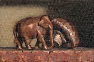 Still life oil painting of a small wooden elephant beside a brown mushroom.
